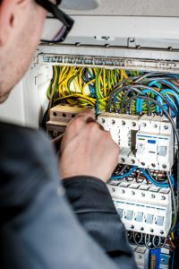 Electrician troubleshooting electrical circuits