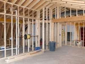 Residential Electrician wiring in an unfinished house
